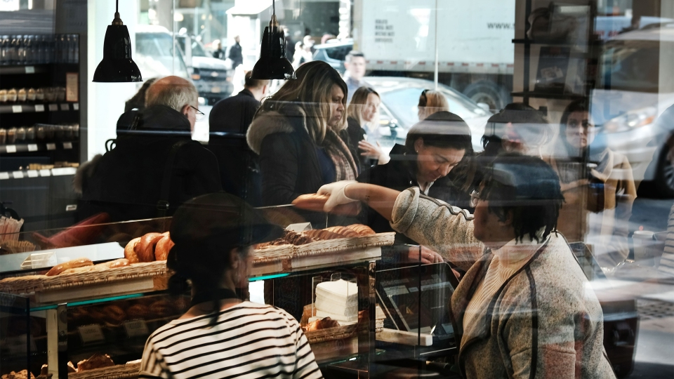 People work in a cafe in midtown Manhattan in February in New York City.