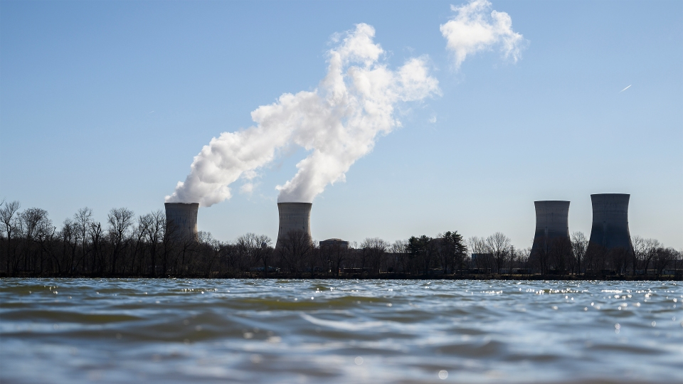 Steam rises out of the nuclear plant on Three Mile Island  in Middletown, Pennsylvania on March 26, 2019.