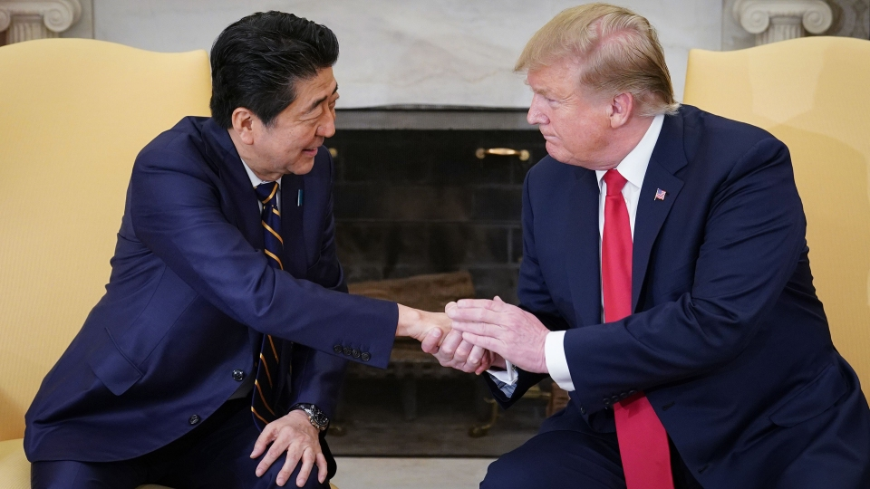 U.S. President Donald Trump shakes hands with Japan's Prime Minister Shinzo Abe during a meeting in the Oval Office of the White House in Washington, DC on April 26, 2019.