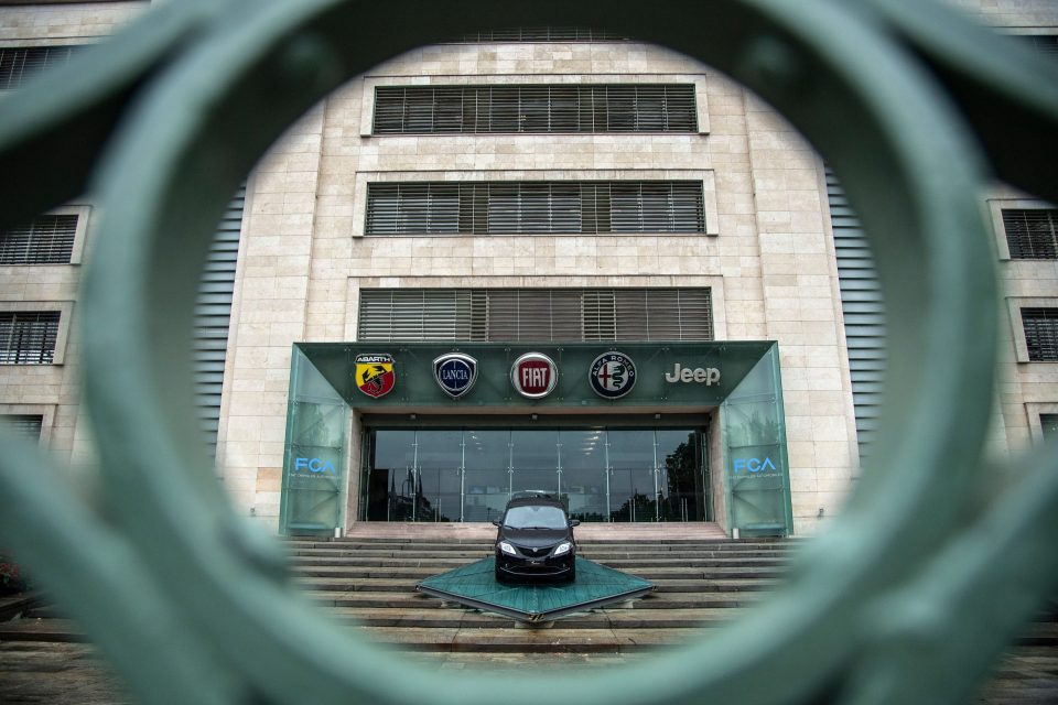 The logos of automobile companies (LtoR) Abarth, Lancia, Fiat, Alfa Romeo and Jeep are pictured at the entrance to the Fiat Chrysler Automobiles (FCA) at the Fiat Mirafiori car plant on May 27, 2019 in Turin, northern Italy. - French and Italian-US auto giants Renault and Fiat Chrysler are set to announce talks on an alliance, with a view to a potential merger.