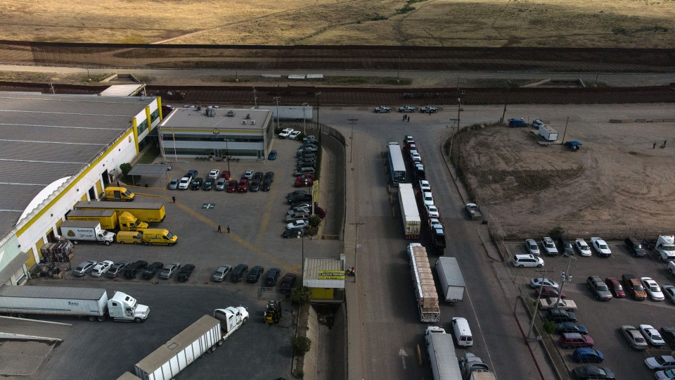 Aerial view of cargo trucks heading to the United States lining up near the commercial port of entry in Otay, in Tijuana, Baja California state on May 30, 2019.