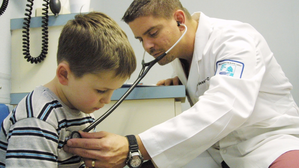 A 6-year-old boy is examined by a physician's assistant in Vivian, Louisiana.