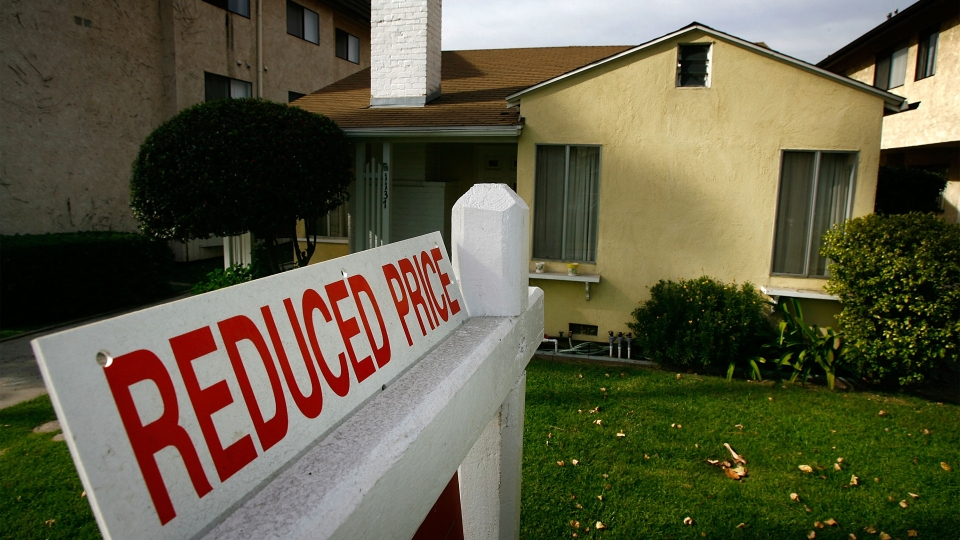 A reduced price sign sits in front of a house in Glendale, California.