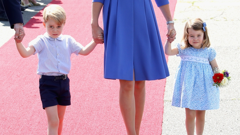 Prince William, Duke of Cambridge, Catherine, Duchess of Cambridge, Prince George of Cambridge and Princess Charlotte of Cambridge arrive at Berlin Tegel Airport during an official visit to Poland and Germany on July 19, 2017.