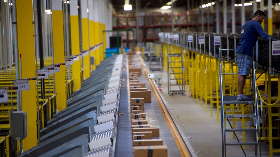 Boxes travel on conveyor belts at an Amazon fulfillment center in Robbinsville, New Jersey, in 2017.