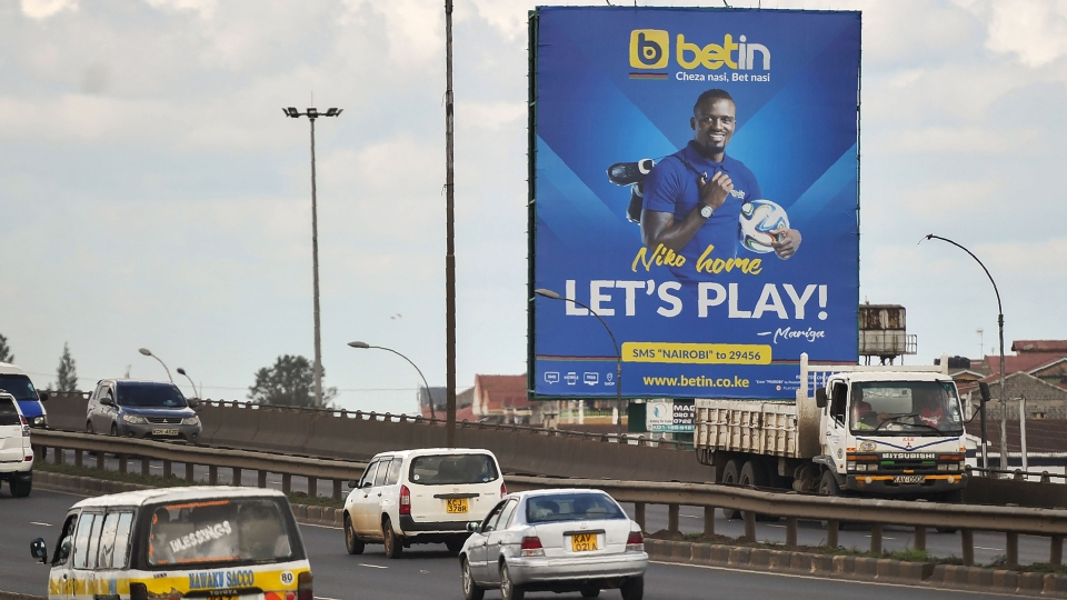 A billboard advertising a popular sports betting site is seen along a highway in Nairobi, on November 8, 2017.
