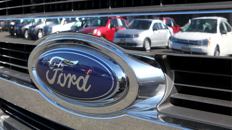 Cars are reflected in the grill of a new Ford truck in Richmond, California.