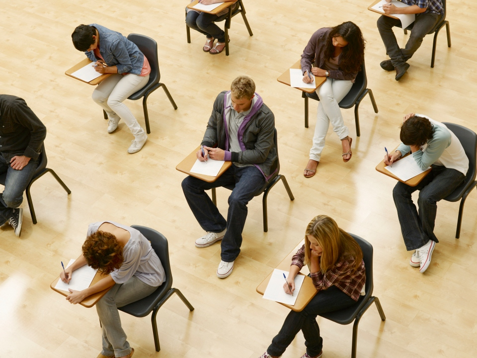 Students taking a test in a classroom.