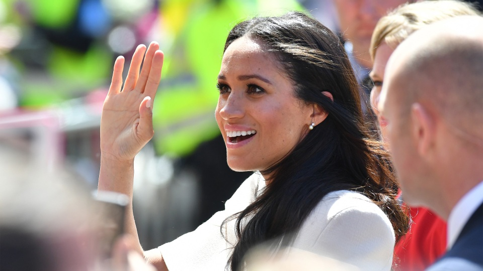 Duchess Meghan Markle waves as she joins Queen Elizabeth II to walk from Storyhouse to Chester Town Hall in on June 14, 2018 in Chester, England.
