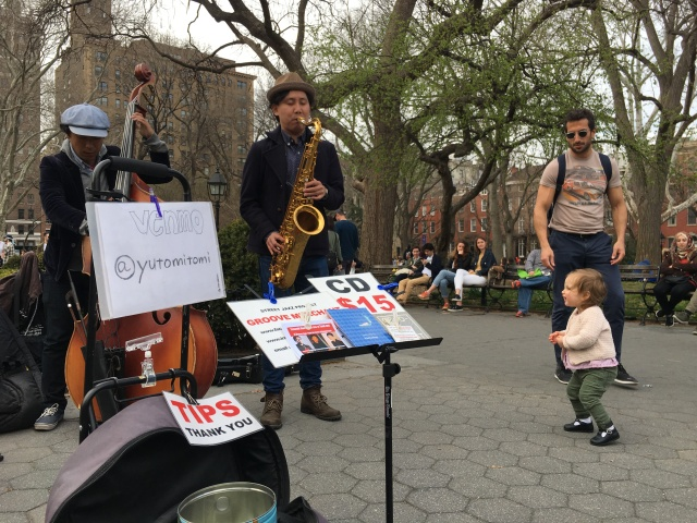 Street performers in Washington Square Park are experimenting with digital tips. Saxophonist Yuto Mitomi offers onlookers his Venmo account information.