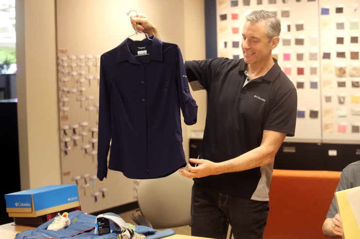 """Jeff Tooze, Vice President of Global Customs and Trade at Columbia Sportswear, shows off a garment with a """"nurse pocket"""" designed to achieve a lower duty rate."""
