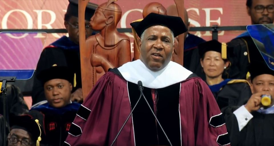 Billionaire philanthropist Robert Smith pledged up to $40 million to pay off Morehouse College graduates' student loans at commencement on Sunday.