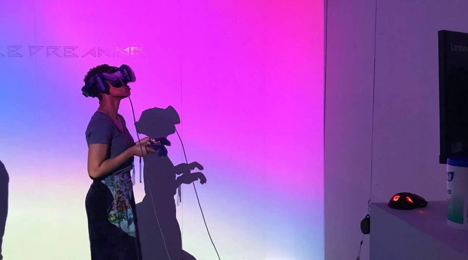 A viewer uses a virtual reality headset at the Tribeca Film Festival.
