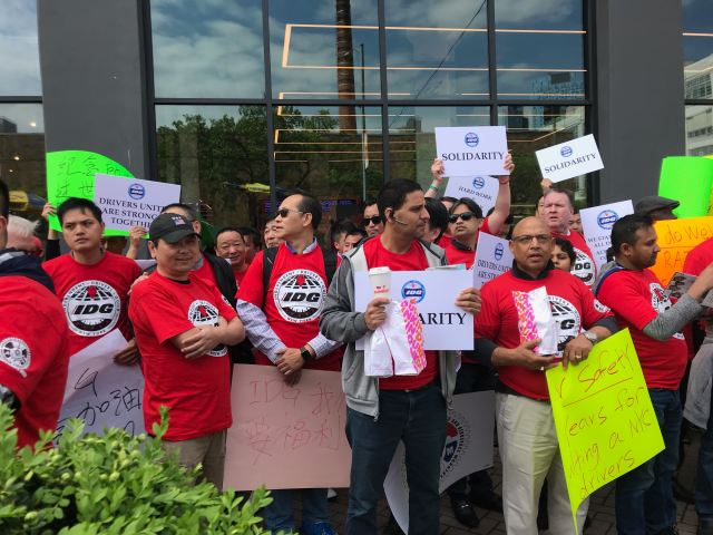 Drivers protest at Uber's New York headquarters.