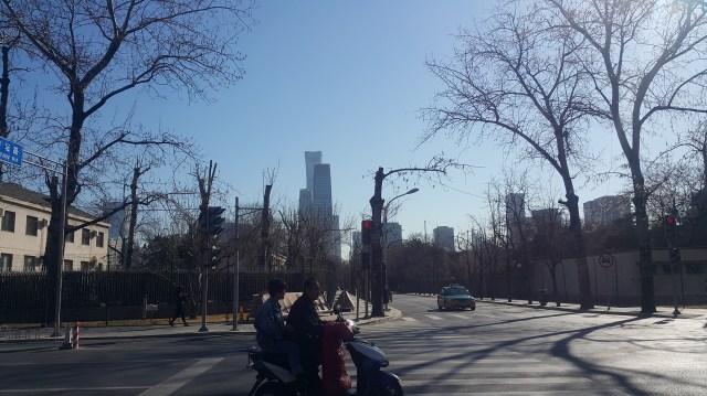 Beijing residents on moped