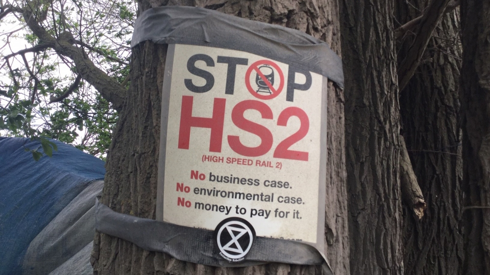 "A ""Stop HS2"" sign posted on a tree."