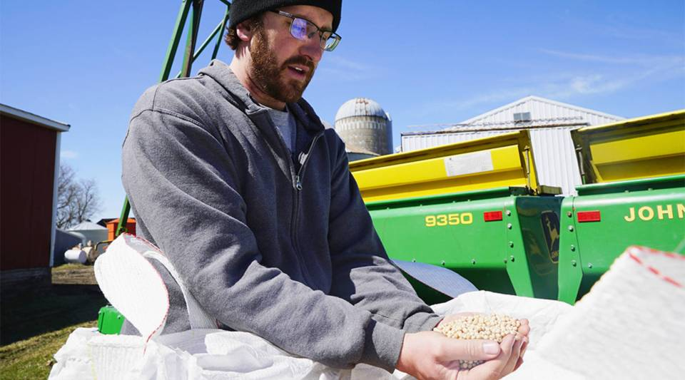 Ryan Klassen inspects pea seeds on his farm in Belgrade, Minnesota. Those peas are the base of the protein being used in a range of products, including energy bars, cereals and milks.