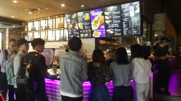 Taco Bell in Shanghai serves shrimp avocado burritos and alcoholic slushies and is one of four branches in the Chinese city. Credit: Jennifer Pak/Marketplace