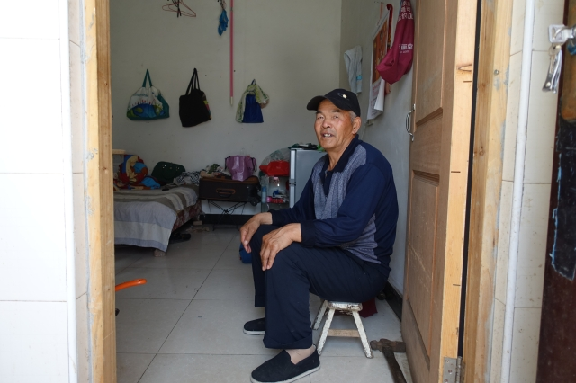 Li Xin'an left his village in central Henan province to work in Shanghai to earn more money but the only work he could find was washing cars, cleaning and collecting garbage. Credit: Charles Zhang/Marketplace