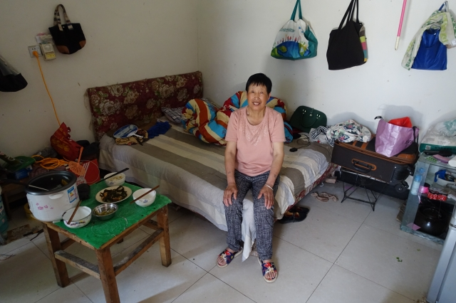 Zhang Rongzhi is working as a cleaner in Shanghai at age 62 because she needed to repay debt on a property, save up for medical emergencies and for her son's wedding. Credit: Charles Zhang/Marketplace