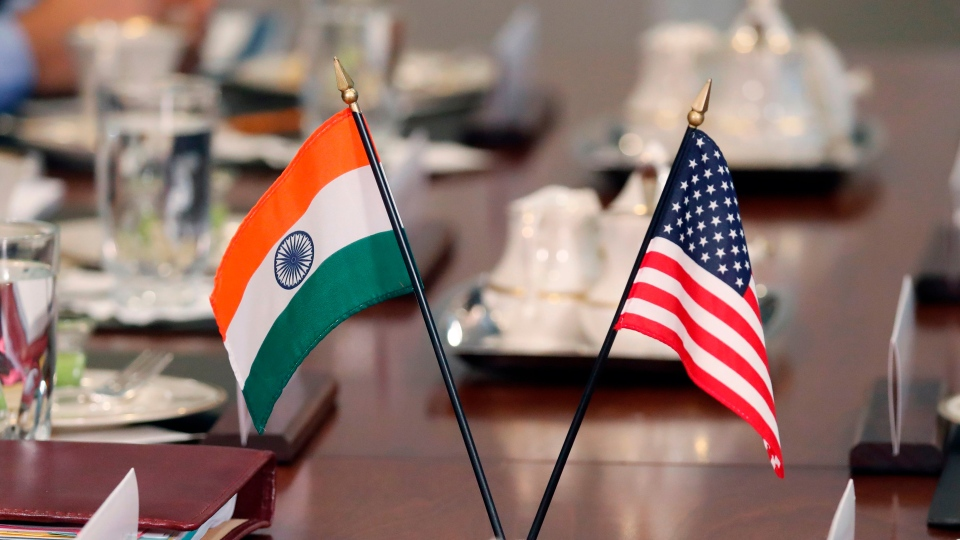 The flags of the United States and India sit on a conference table during a meeting at the Pentagon in Washington, D.C. in 2018.