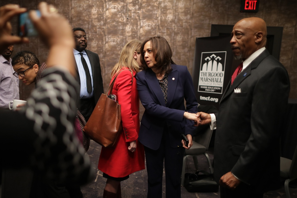 Democratic presidential candidate Sen. Kamala Harris (D-CA) talks with a member of her staff while meeting with leaders from historically black colleges and universities in Washington, D.C. in February.