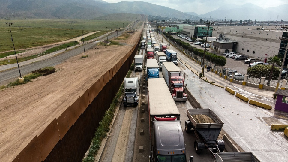 Cargo trucks line up to cross into the U.S. at the Otay Mesa crossing port in Tijuana, Mexico, in April.