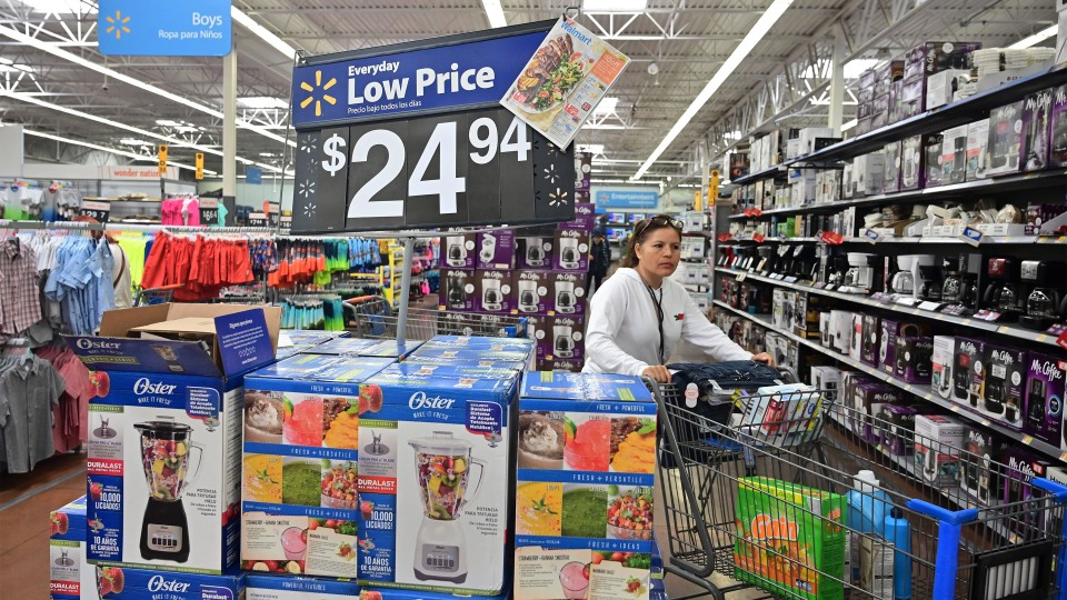 Tariffs are showing up in higher prices and some consumers are having to be strategic about their purchases. Above, a woman shops at a Walmart store in Rosemead, California in May.