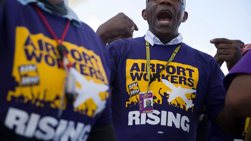 Jean Pierre Louis joins with other workers to protest against possible job layoffs at the Fort Lauderdale-Hollywood International Airport on May 01, 2019 in Fort Lauderdale, Florida.