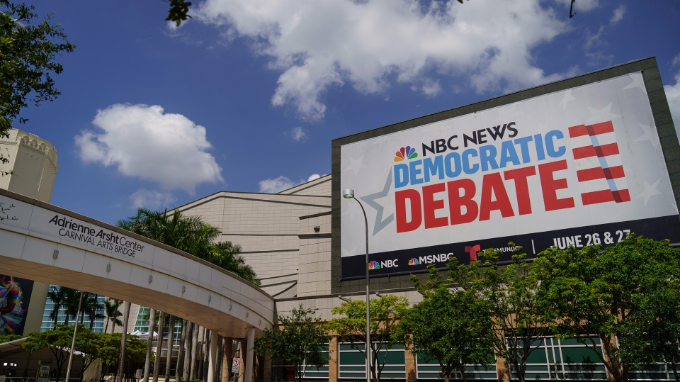 A sign advertises the first Democratic presidential primary debates for the 2020 election, which take place June 26 and 27 in Miami, Florida.