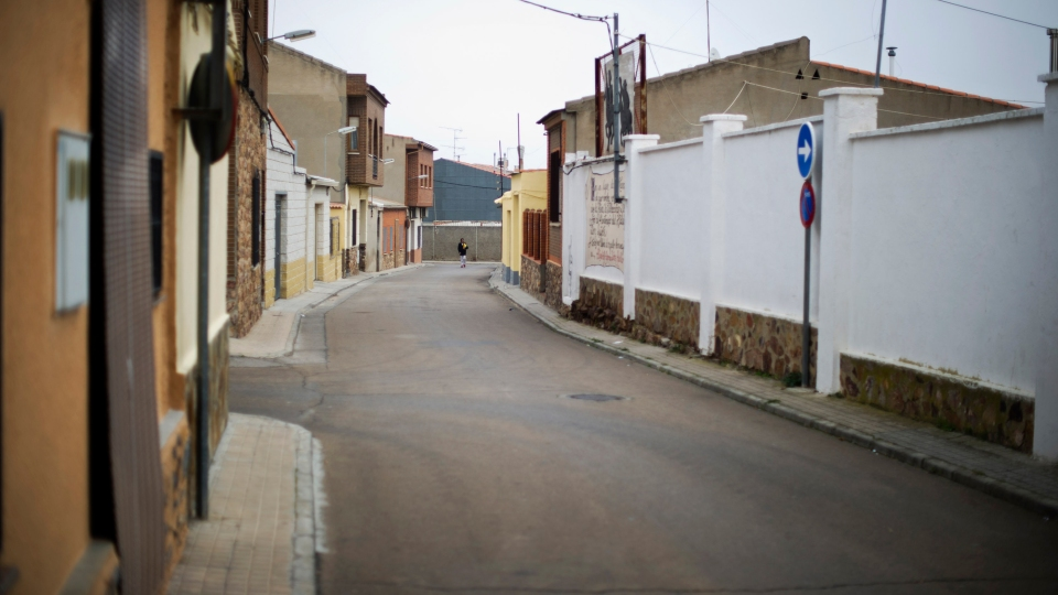 A man walks through a deserted street in Villacanas, Spain, which was abandoned as the main factory closed in 2012.