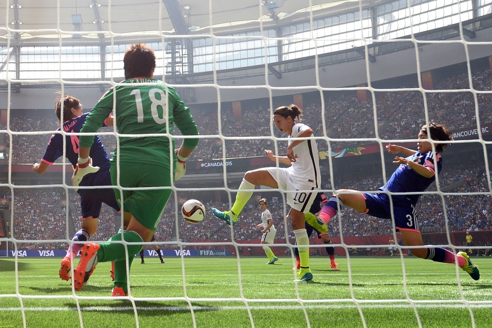 Carli Lloyd of the U.S. scores the team's second goal against Japan in the 2015 Women's World Cup final in Vancouver, Canada.
