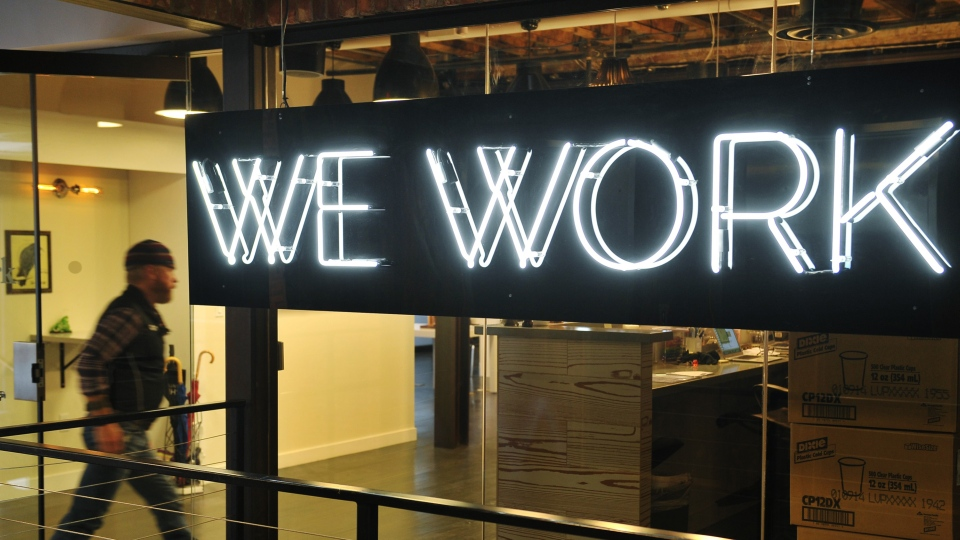 A man walks into a WeWork office in Washington, D.C.