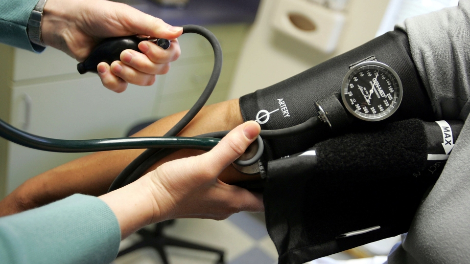 A doctor takes a patient's blood pressure in Dorchester, Maryland.