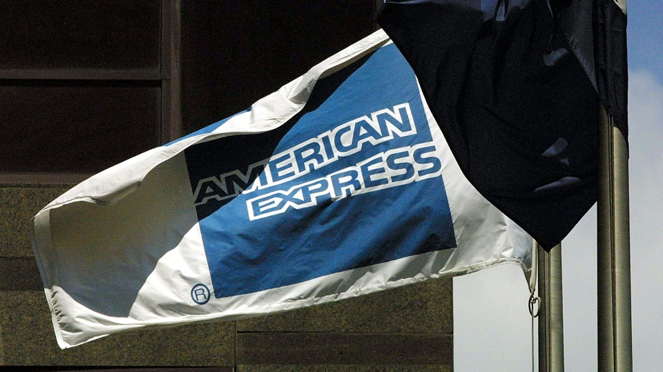 An American Express flag blows in the wind in front of corporate headquarters in New York City. American Express Co. is one of 17 banks exempt from this year's stress test.