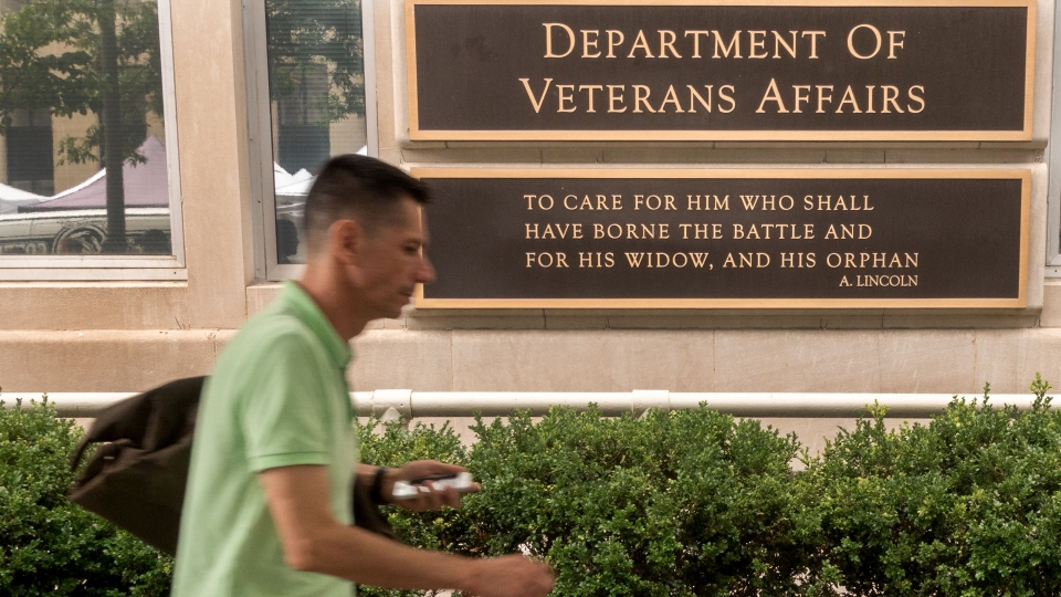 A man walks by the Department of Veterans Affairs, July 27, 2017, in Washington, DC.