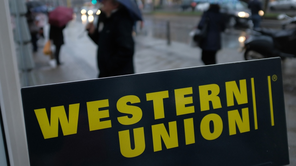 A sign advertises the money transfer service Western Union, often used to send remittances, in Berlin Germany.