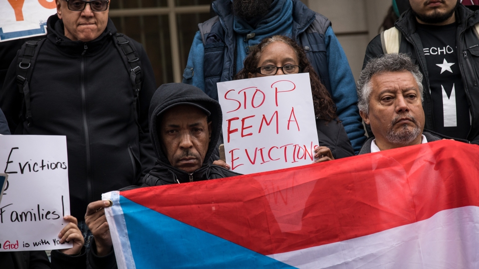 Activists rally in support of Puerto Rican families displaced by Hurricane Maria, on the steps of City Hall, April 19, 2018 in New York City.