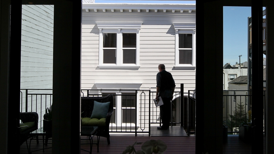 A real estate agent tours an open house in San Francisco, California.