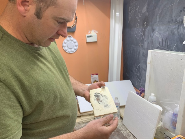 Wyoming Fossil's owner Robert Bowen showing a fish fossil he found nearby.