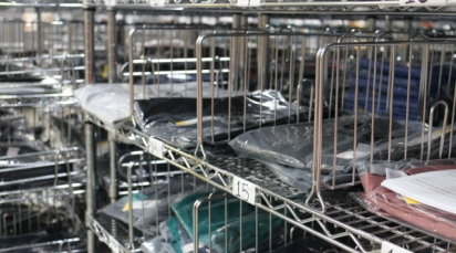 Racks of scrubs at FIGS' warehouse in Industry, California.