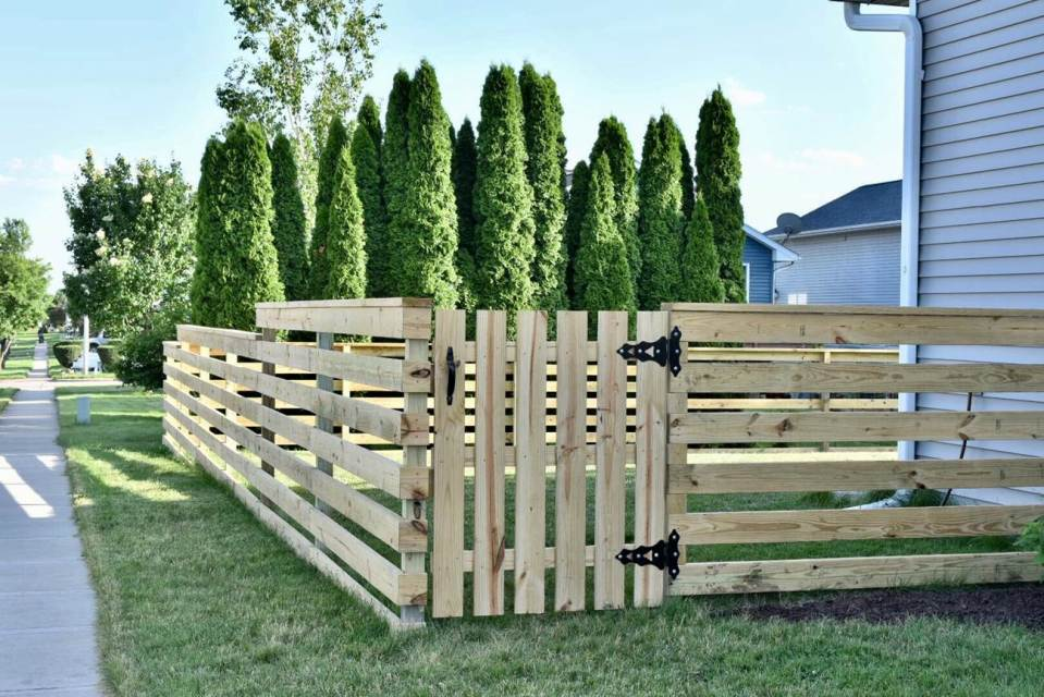 Kelsey Sprowell of Iowa City, Iowa, chose to build this fence with her family to save money.
