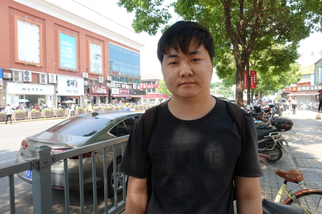 """Mechanial engineering student Sun Wenhao is among the many men in China who feel pressure to buy property after they enter the workforce in order to be considered """"marriage material."""" Credit: Charles Zhang/Marketplace"""
