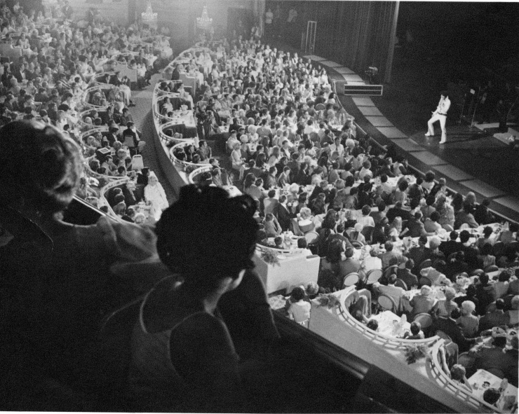 Elvis performing in front of a large crowd in Las Vegas