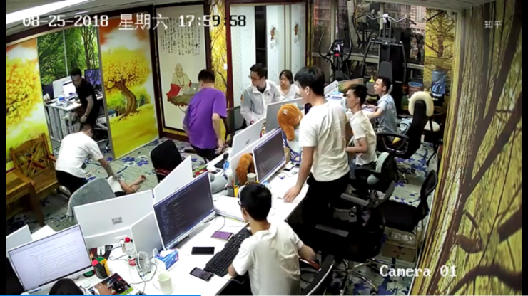 Screen grab of security camera footage of a 24-year-oldprogrammer who fainted at work in Shenzhen in 2018. The date on the footage shows the incident happened close to 6 p.m. on a Saturday. Local media reports say he fainted after working continuous overtime.