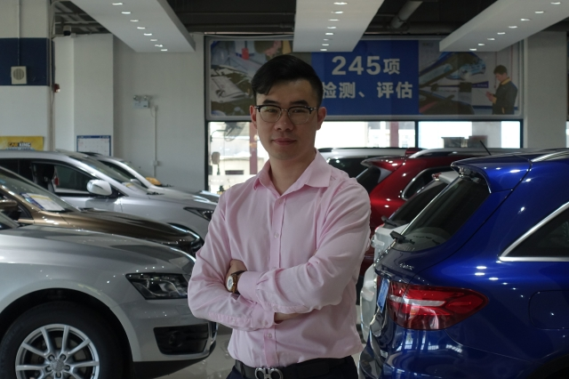 Min Zhihao, sales director at Car King, saved 50% of his income when he first entered the workforce. Credit: Charles Zhang/Marketplace