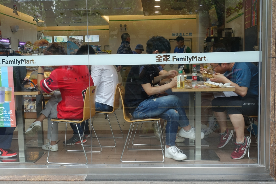Workers on a lunch break in Shanghai. According to the job site, Zhaopin, the average worker spends 20 yuan ($2.90) or less per lunch. Convenience stores like this one are one of the few places that offer cheap meals in office areas.