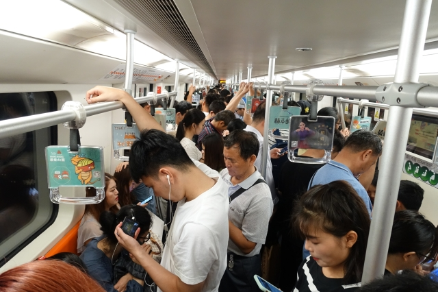 Shanghai's crowded subway in the morning. The average commute to work in Shanghai is 7.7 miles, which takes almost an hour. Credit: Charles Zhang/Marketplace