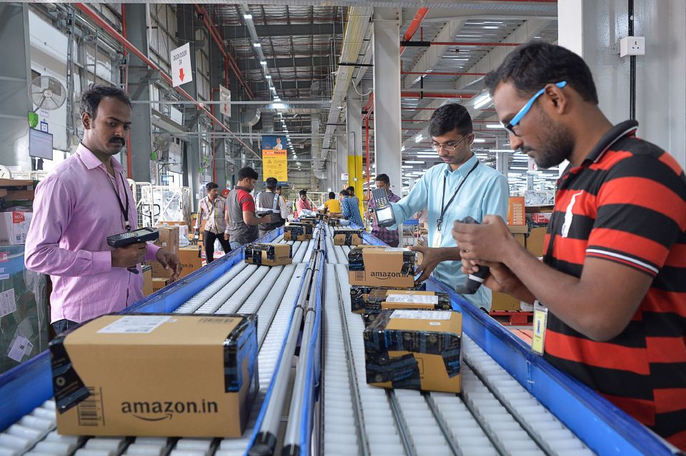 Employees of Amazon India scan packages at Amazon's newly launched fulfilment center on the outskirts of Bangalore.  (Photo: MANJUNATH KIRAN/AFP/Getty Images)