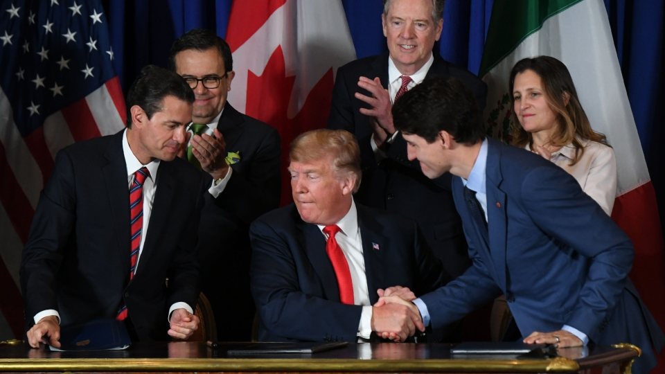 Mexican President Enrique Pena Nieto (L), US President Donald Trump (C) and Canadian Prime Minister Justin Trudeau are pictured after signing a new free trade agreement in Buenos Aires, on November 30, 2018, on the sidelines of the G20 Leaders' Summit.
